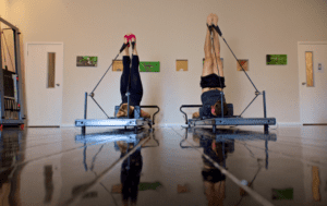 photo of people using Pilates reformers in Melbourne